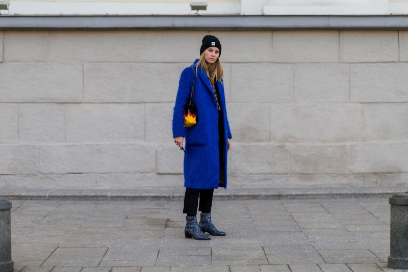 MOSCOW, RUSSIA - OCTOBER 16:  Tine Andrea wearing a blue wool coat and chelsea boots and wool hat and small bag with fire print on October 16, 2016 in Moscow, Russia. (Photo by Christian Vierig/Getty Images) *** Local Caption *** Tine Andrea
